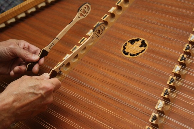 Center yourself on the hammered dulcimer's treble bridge